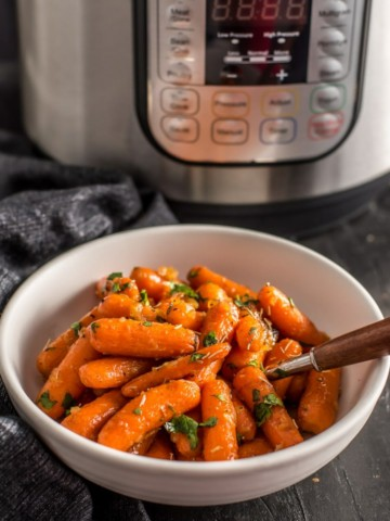 Instant Pot Honey glazed carrots served in a white bowl