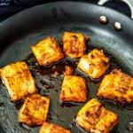 Cooked Tandoori Salmon in a non-sitck pan.