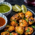 Tandoori chicken tikka served with green chutney and tamarind chutney along with lemon wedges