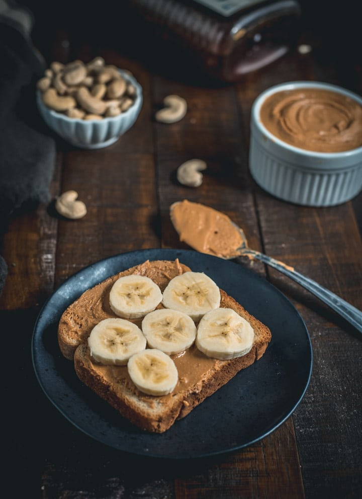 A toast spread with cashew butter and bananas on top