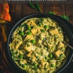 A black bowl of creamy methi matar malai on a wooden table with the words Easy Methi Matar Malai Recipe with Paneer Fenugreek and Green Peas Curry at the top.