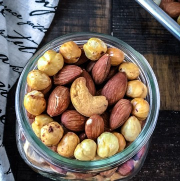 An overhead shot of nuts in a glass container