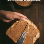 Spreading almond butter on a slice of bread