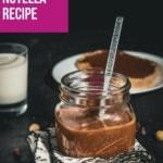 A glass jar filled with chocolate hazelnut spread