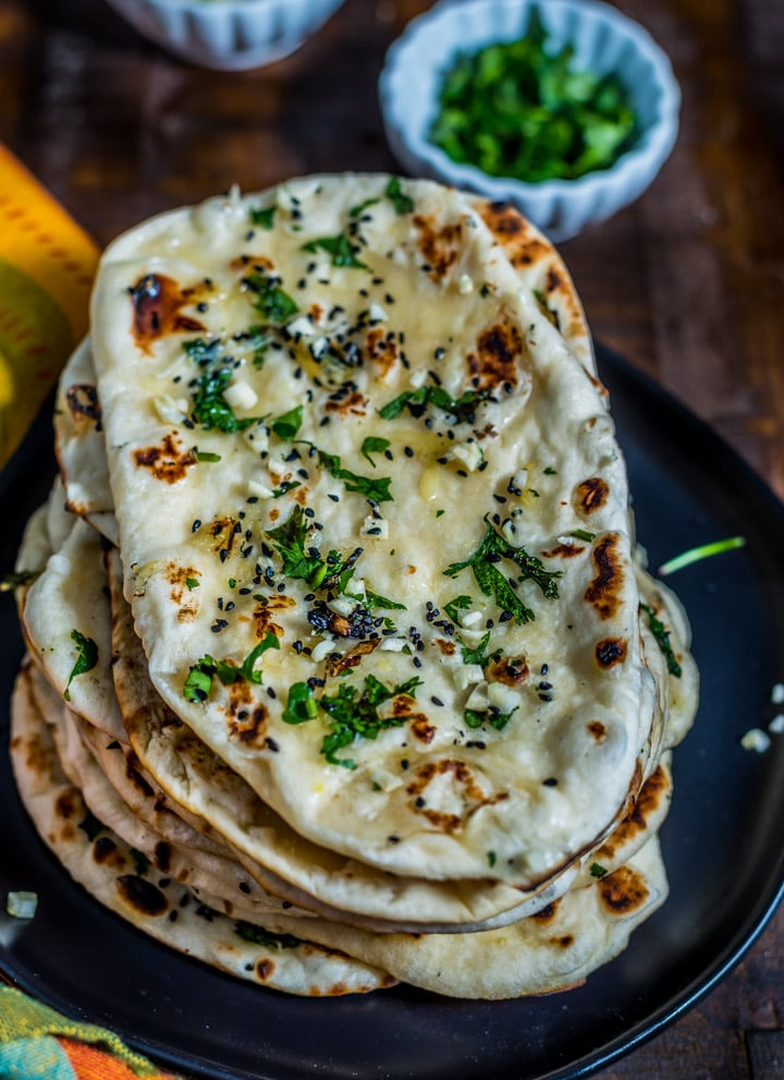 A stack of fresh naan bread.