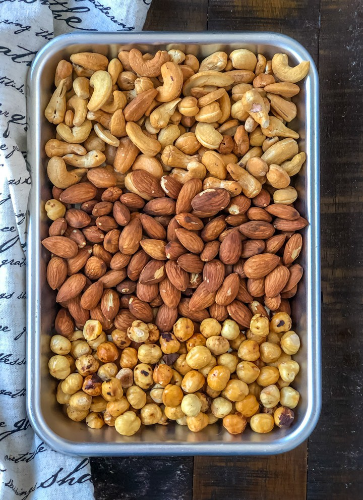 An overhead shot of roasted cashews, almonds and hazelnuts