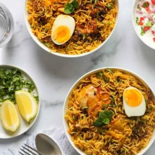 Two bowls of Chicken Biryani in white bowls