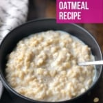 A black bowl with fresh oatmeal and a little milk on top with a spoon in the right of the bowl and a towel to the left of the bowl with the words Best Ever Instant Pot Oatmeal Recipe in the top right of the picture.