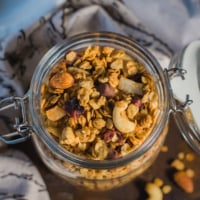 An overhead shot of granola in a glass container