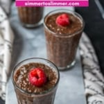 Three glassed filled with Chocolate Chia Pudding placed on a marble tray