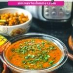 Udupi rasam served in a glass bowl