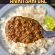 A ladle filled with langar ki dal