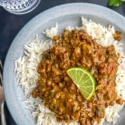 Langar ki dal served with jeera rice and a slice of lime