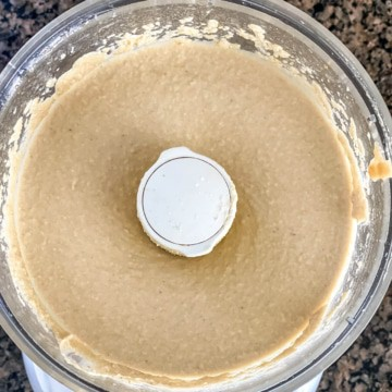Creamy blended instant pot hummus in a food processor.