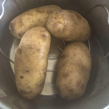 Four potatoes in an instant pot after cooking.