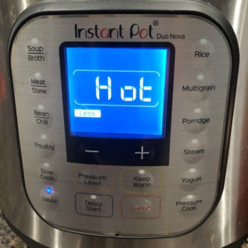 Preheating the instant pot pressure cooker.