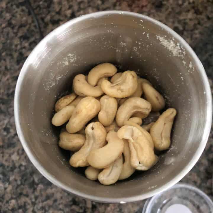 Unsalted cashews in a spice grinder