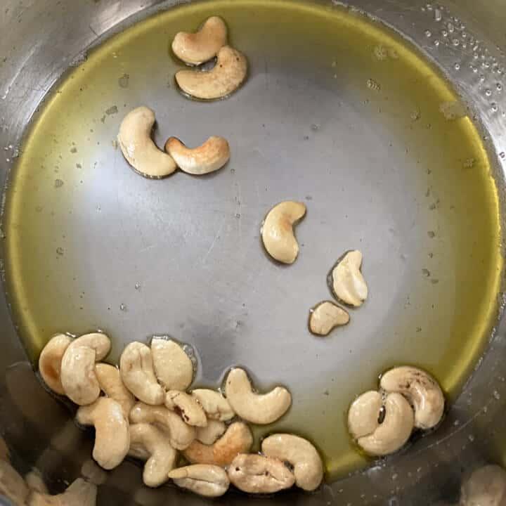 cashews being fried in ghee in an Instant Pot