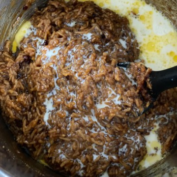 milk and ghee added to cooked pongal