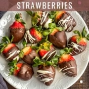 A white plate with chocolate dipped strawberries on a wooden counter with sprinkles and the words how to make chocolate covered strawberries at the top.