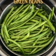 An instant pot with green beans in a steamer basket and the words Instant Pot Green Beans at the top.