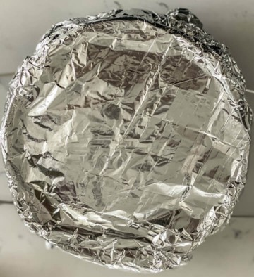 Foil on top of a springform pan with instant pot lasagna.