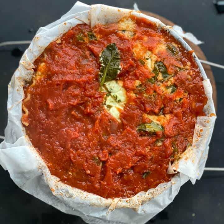 A springform pan with instant pot lasagna after baking without foil.
