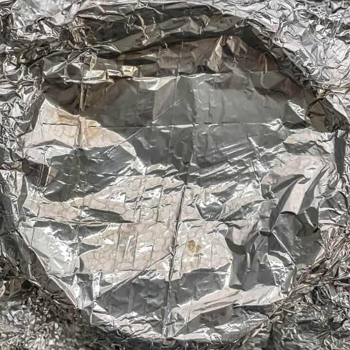Foil back on top of a springform pan.