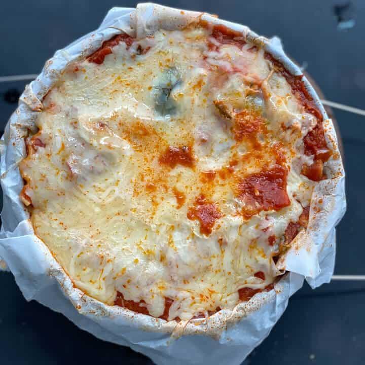 Finished instant pot lasagna on a trivet.