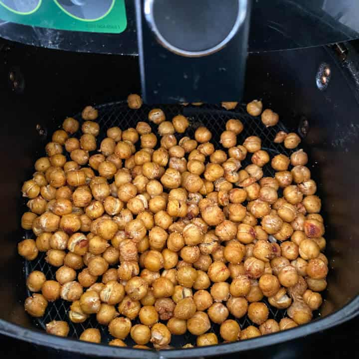 Air fryer roasted chickpeas in the air fryer after roasting.