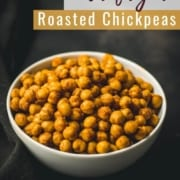 A white bowl with air fryer roasted chickpeas on a black towel and the words Air Fryer Roasted Chickpeas at the top.