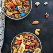 The words homemade healthy trail mix at the top with two small bowls of trail mix on a grey counter below.