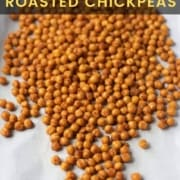 A white towel with crispy roasted chickpeas spilled out on the towel with the words Spicy and Crunchy Roasted Chickpeas at the top.