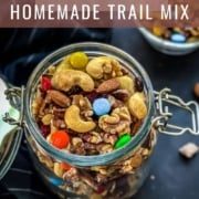 A glass jar with homemade trail mix and the title how to make homemade trail mix at the top.