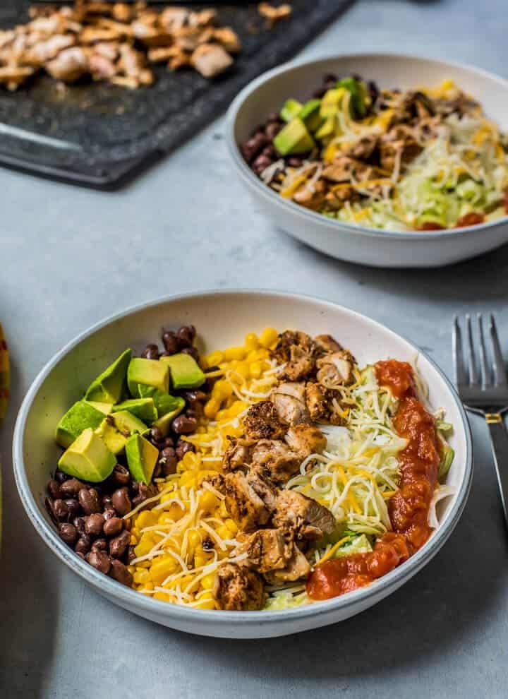 chipotle chicken burrito bowl in a white serving bowl for lunch or dinner