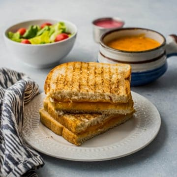 grilled cheese on a white plate
