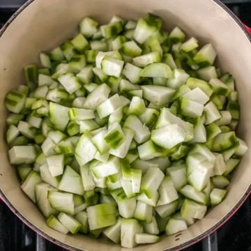 Chopped turiya pieces added to a casserole